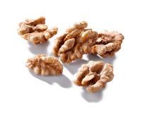 Walnut kernels macro  isolated on white Royalty Free Stock Photo