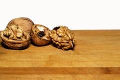 Walnuts. Walnut kernels and whole walnuts on background Royalty Free Stock Image
