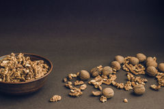 Walnut kernels and whole walnuts Stock Images