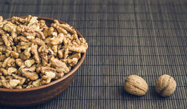 Walnut kernels and whole walnuts Stock Image