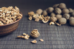 Walnut kernels and whole walnuts Stock Photography