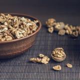 Walnut kernels and whole walnuts Stock Photo