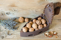 Walnut kernels and whole walnuts. On rustic old wooden table Stock Photo
