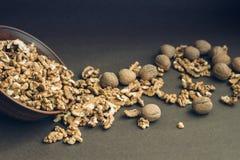 Walnut kernels and whole walnuts Stock Photography