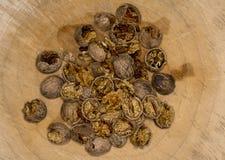 Walnut kernels   and whole walnuts wood background Royalty Free Stock Photos