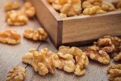 Walnut kernels on wooden table Stock Photography