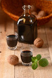 Walnut liqueur in the bottle Royalty Free Stock Photos