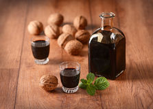 Walnut liqueur in the bottle. Nocino in the bottle - Traditional Italian liqueur royalty free stock photography
