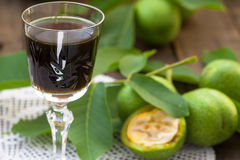 Walnut liqueur with green walnuts royalty free stock image