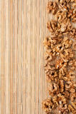 Walnut  lying on a bamboo mat Stock Photo