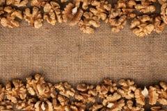 The walnut lying on burlap Royalty Free Stock Image