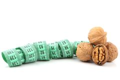 Walnut and meter Stock Images