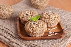 Walnut muffins, horizontal. Walnut muffins decorated mint, close up Royalty Free Stock Image