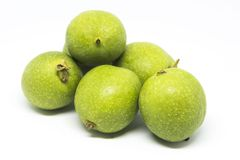 Green walnut. A walnut is the nut of any tree of the genus Juglans Family Juglandaceae, particularly the Persian or English walnut, Juglans regia. Technically a Stock Image