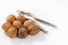 Walnut with nutcracker Stock Photo