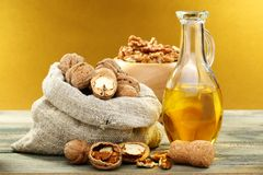 Walnut oil in bottle and nuts. Royalty Free Stock Photo