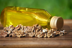 Walnut oil in bottle and nuts Stock Photography