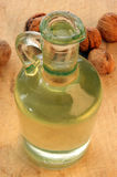 Walnut oil in a glass bottle Stock Images