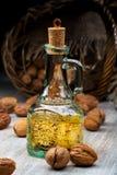 Walnut oil in a glass bottle Stock Image