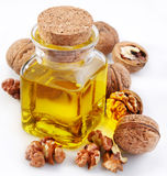 Walnut oil with nuts Stock Photo