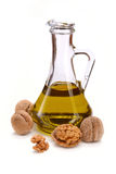 Walnut oil with nuts Royalty Free Stock Photo