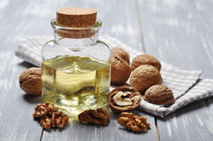 Walnut oil with nuts Royalty Free Stock Images