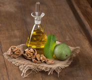 Walnut oil and nuts on wooden table Stock Photography
