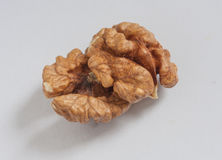 Walnut pieces on the white background. Cracked walnut pieces on the white background Royalty Free Stock Photos