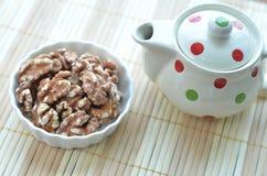 Walnut with a Pot of Tea Stock Photo