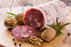 Walnut Salami. As closeup on a wooden board Royalty Free Stock Photography