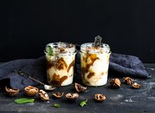 Walnut and salted caramel ice-cream in glass jars Royalty Free Stock Image