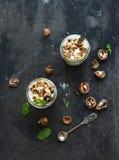 Walnut and salted caramel ice-cream in glass jars Stock Photo