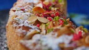 Walnut shavings on cake close up, macro. Delicious dessert cakes. Homemade pastries. Nut cake stock video footage