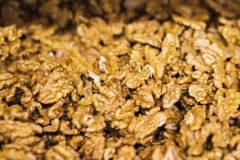 Walnut without shell on the counter of the grocery market. Harvest nutritious nuts in the store. Vegetarian healthy diet. Ingredients for salads, appetizers stock photos