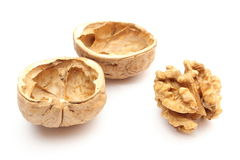 Walnut without shell and nutshells on white background Stock Photography