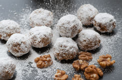 Walnut Snowball Cookies. Homemade walnut snowball cookies with powdered sugar royalty free stock photo