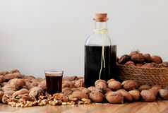 Walnut spirit. Homemade liqueur. Homemade liqueur. Alcoholic drink made from walnuts and rum Stock Photography