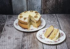 Walnut sponge cake on wooden background. Close up royalty free stock images