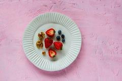 Walnut, strawberry and bluebbery royalty free stock photography