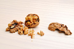 Walnut on the table heading. Walnut on a white wooden table Stock Image