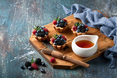 Walnut tartlets with custard and berries Royalty Free Stock Image