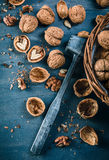 Walnut top view wicker basket on old Royalty Free Stock Photography