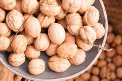 Walnuts. In the metal dish Stock Photos
