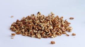Walnut on white background. Spill purified walnut on white background, Drupe pile heap Royalty Free Stock Image