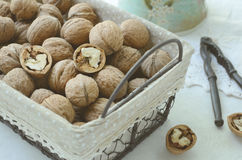 Walnut in wire basket Stock Image