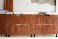 Walnut wood kitchen construcion modern design Stock Image