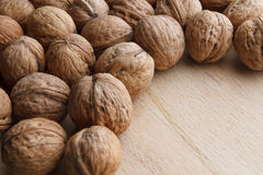 Walnut on wooden background Stock Photography