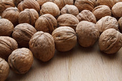 Walnut on wooden background Stock Images