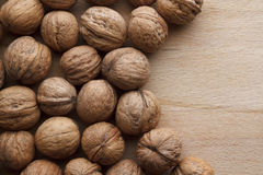 Walnut on wooden background Royalty Free Stock Photos