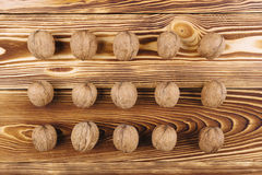 Walnut on the wooden background Royalty Free Stock Images
